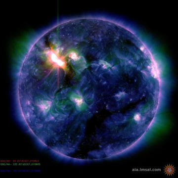This color-coded image combines observations made by NASA's Solar Dynamics Observatory in several extreme ultraviolet wavelengths, highlighting a bright X-class flare toward the upper left of the sun's disk on March 6.